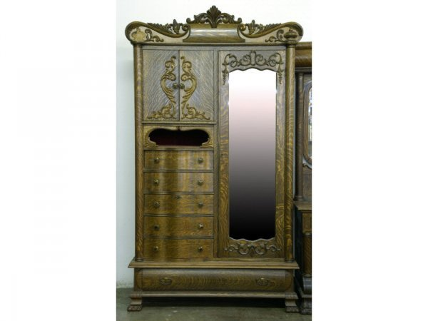 Golden oak armoire with built-in chest of drawers