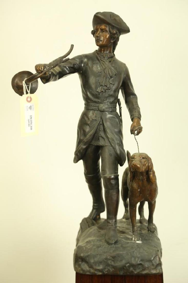 ANTIQUE BRONZE HUNTER AND DOG SCULPTURE