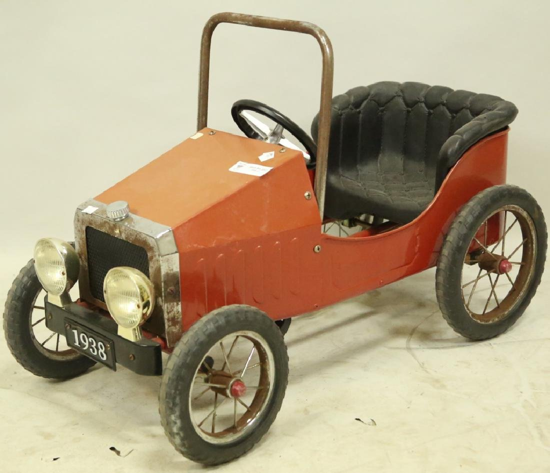 VINTAGE STEERABLE PEDAL CAR ON HARD RUBBER WHEELS