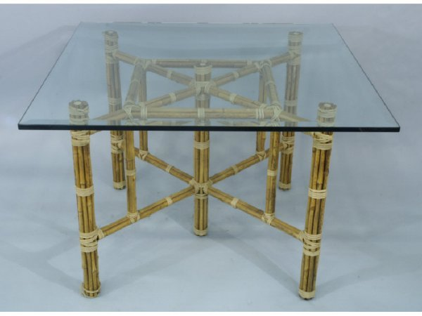 1021: Maguire bamboo game table with glass top.