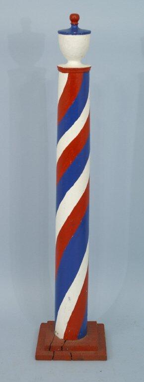 "3: A vintage barber pole. Size: 11"" x 54"" x 11""."