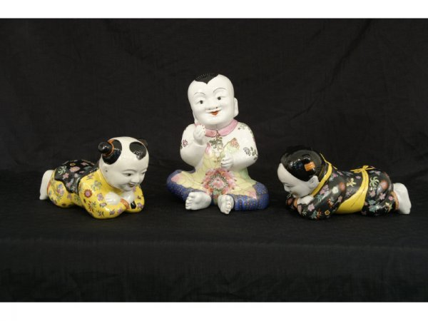 7: Set of three porcelain oriental children