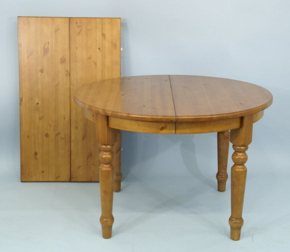 """1013: Round pine table with 2 leaves. Size: 46"""" x 30"""","""