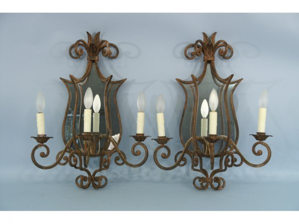 1020: Pair of metal sconces with mirror backs. Size: 17