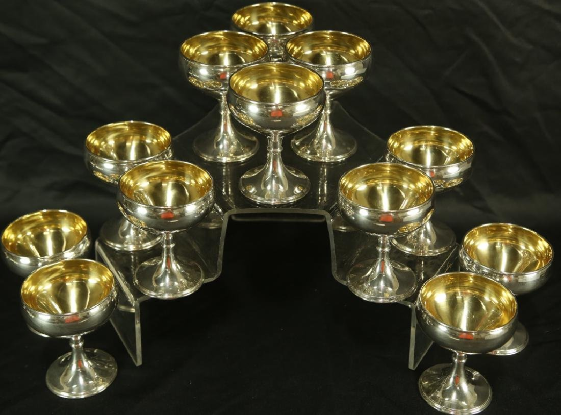 SET OF TWELVE STERLING SILVER CUPS