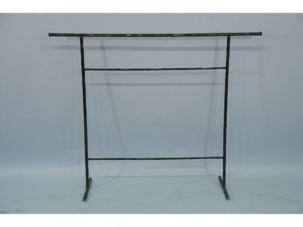21: Wrought iron quilt rack.