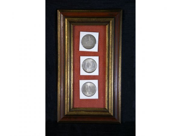 1: 3-piece set of silver dollars in wall frame. Include