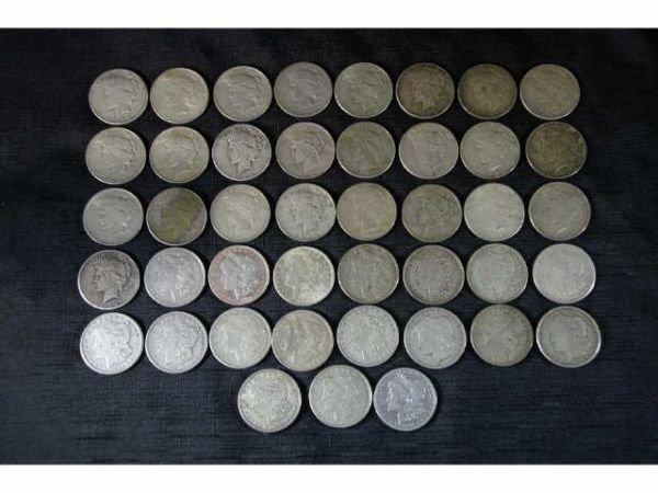 9: 18 Morgan dollars and 25 Peace dollars.