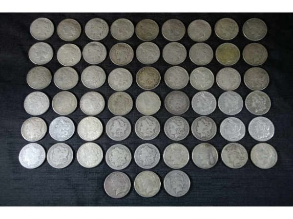 10: 57 assorted coins.  32 Morgan dollars and 25 Peace