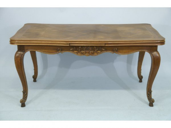 1011: Antique draw leaf dining table.