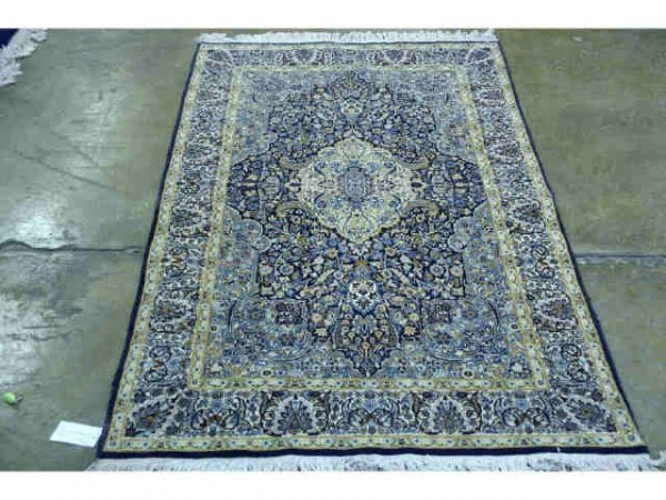 1017: Navy and cream hand knotted oriental rug.