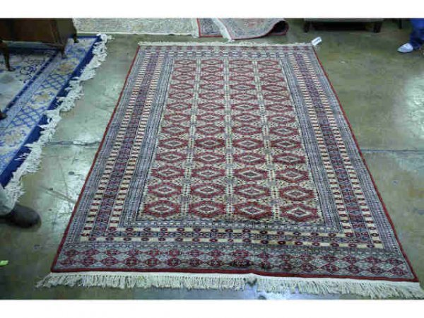 1018: Hand knotted, red and taupe bokhara.