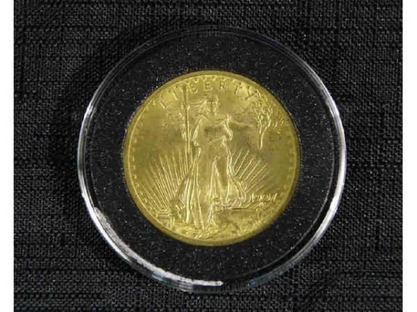 1024: 1907 $20 St. Gaud gold coin. Condition: BU 60/62