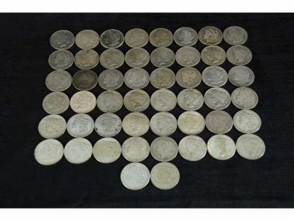1010B: 50 pieces of silver dollars. Mixed set includes