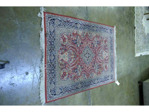 4: Hand knotted, red, khaki, and navy Persian rug.