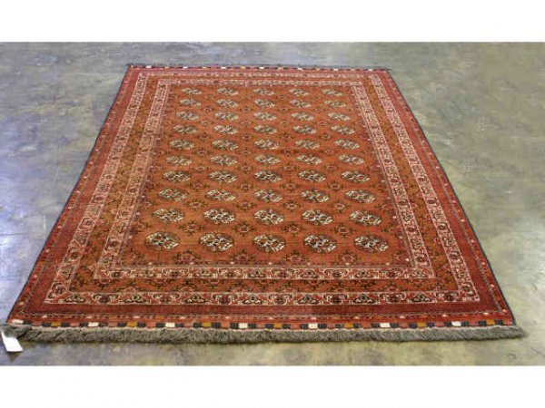 15: All red rug with circular designs.