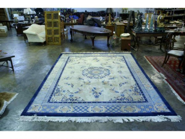 16: Hand knotted, Oriental patterned rug.