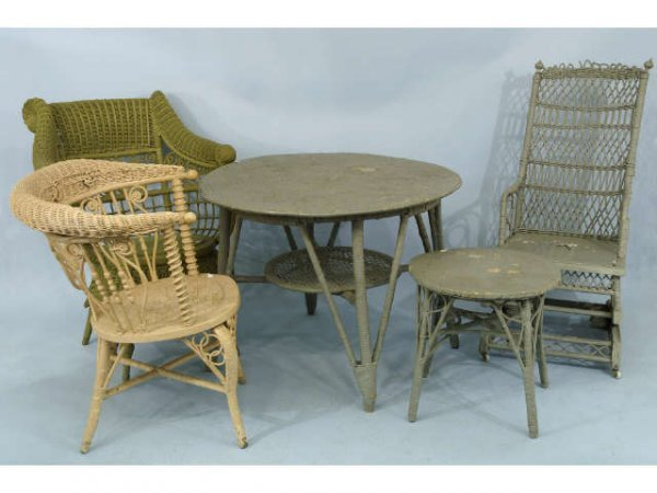 17: Mixed assortment of wicker furniture. Includes two