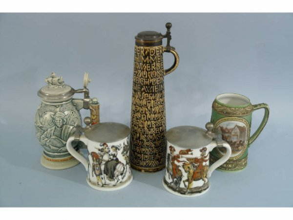 22: Five steins of various sizes and decorations.