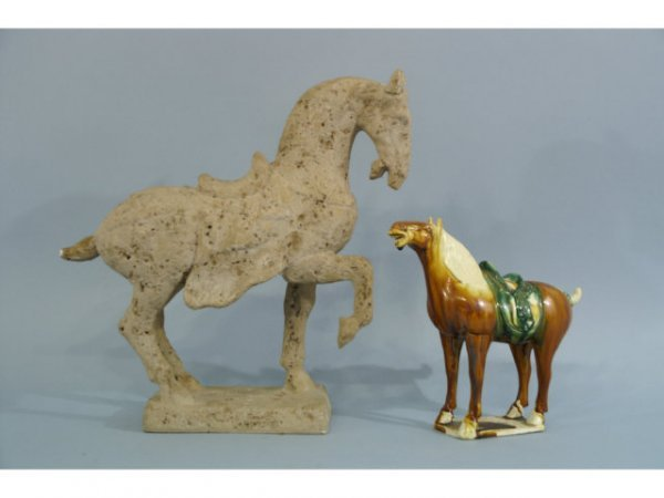 23: Two,small horse statues.