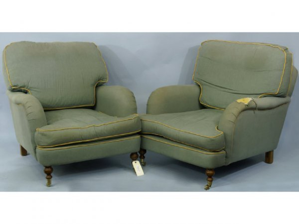 167: Pair of green upholstered armchairs with the front