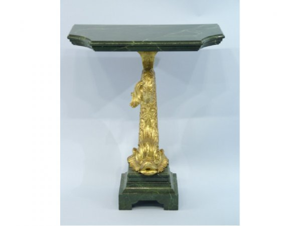1005: Table with gilt dolphin sculpture.