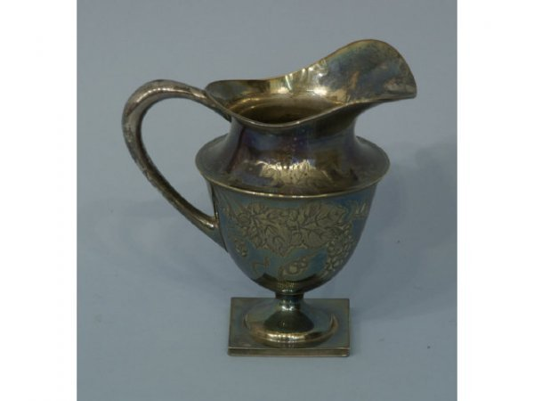 1006: Antique, silver plated water pitcher.