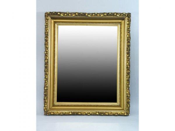 13: A mirror in a very nice ornate gilt frame.