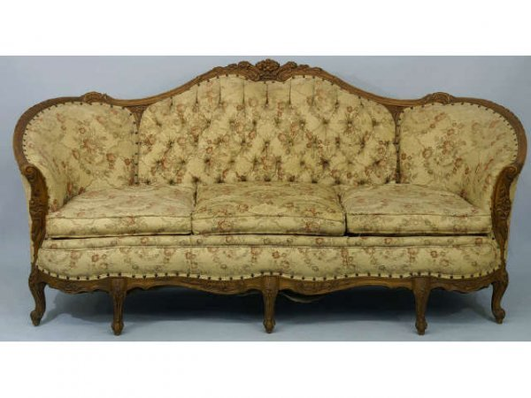 16: French Victorian sofa with a camelback.