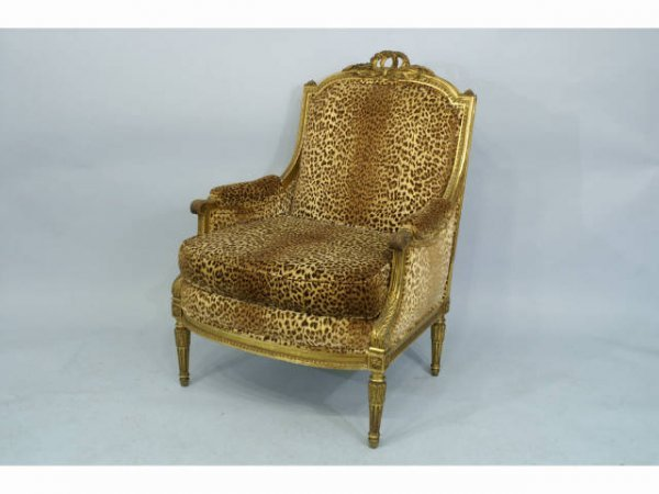 88: French gilt armchair with cheetah pattern.