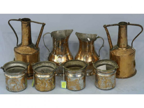 1010: An assortment of copper-plate pitchers and contai