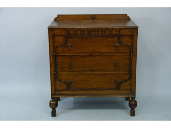 1019: Three drawer dresser with applied composition des