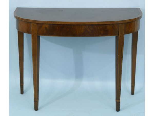 2017: Mahogany demilune table with drawer and ebony and