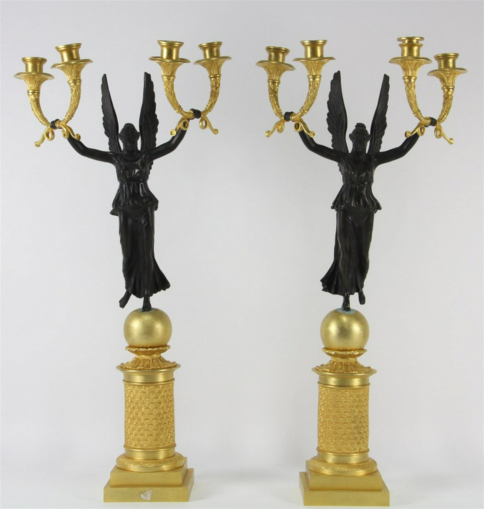 PAIR OF BRONZE WINGED VICTORY CANDELABRA