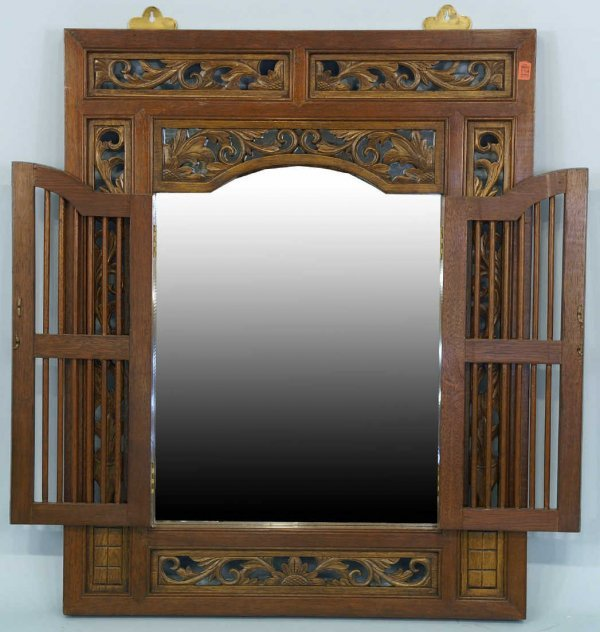 1004: Large hand-carved mahogany mirror with doors and