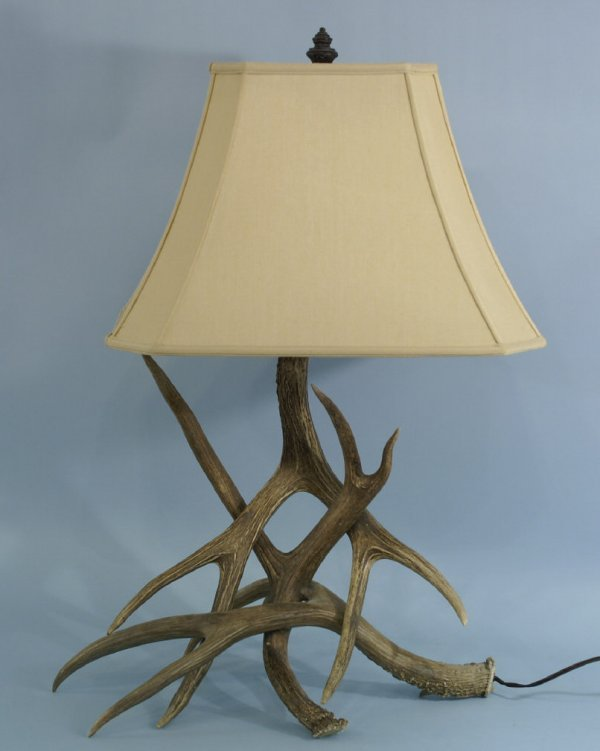 1015: Large antler lamp with shade.