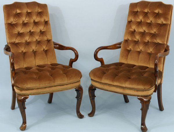 1018: Pair of brown button-tufted armchairs.