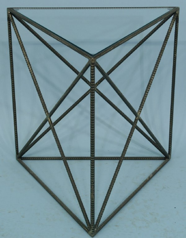 1023: Small wrought-iron triangular glass-top table.
