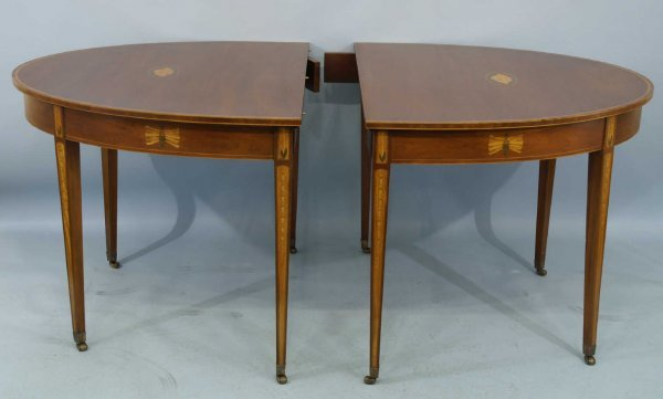 2144: ENGLISH OVAL DINING TABLE WITH INLAY ON CASTERS