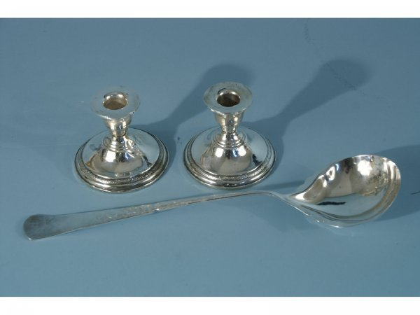 1009A: REED & BARTON LADLE AND PAIR OF CANDLESTICKS