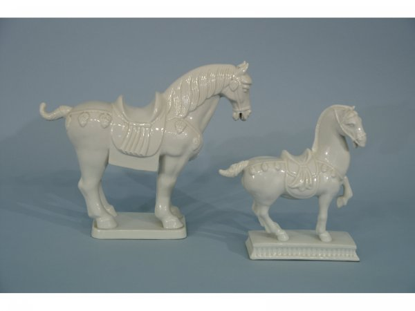 2003: TWO WHITE CHINA HORSE STATUETTES