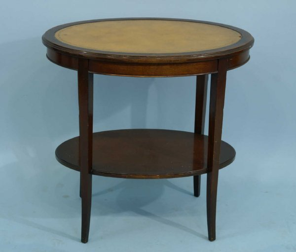 1008: OVAL MAHOGANY END TABLE WITH TOOLED LEATHER TOP