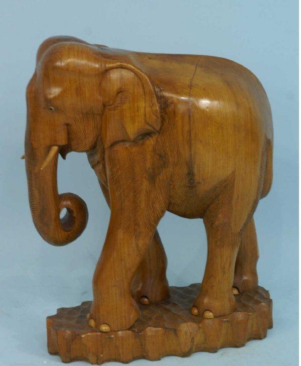 1009: A CARVED WOOD ELEPHANT FIGURE
