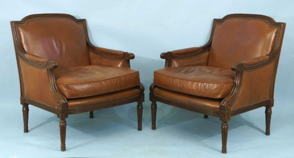 67: CARVED WOOD AND LEATHER ARMCHAIRS BY BAKER