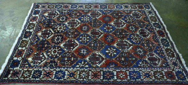 1015: HERIZ RUG IN RED AND BLUE