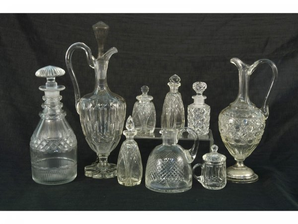1002: BOX LOT OF NINE PIECE CRYSTAL DECANTERS