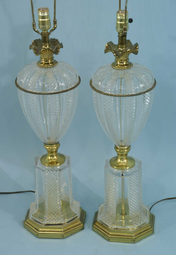 1004: A PAIR OF PRESSED GLASS AND BRASS LAMPS