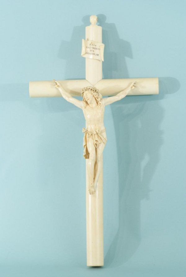 19: ANTIQUE BONE CHRIST FIGURE ON CRUCIFIX