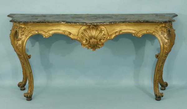 102: A CARVED GILTWOOD CONSOLE