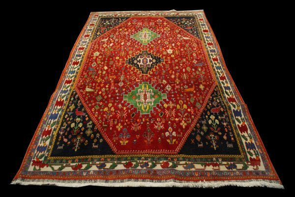 158: COLORFUL RUG IN A RED BACKGROUND